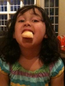 Erin Eating Her Hamantaschen